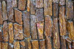 Wall stone. The wall brown stone background Stock Photography