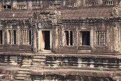 Wall with stone carved decoration of ancient Khmer temple Stock Photo