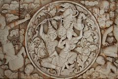 Wall stone carving sclupture of Ramakien Performance in the middle of heaven forest, the glory of Rama story Stock Image