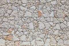 Wall stone masonry light gray. Irregular fragment. Royalty Free Stock Photos