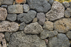 Wall of stone rock boulders royalty free stock photography