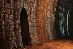 Wall in a stone tunnel Royalty Free Stock Photos