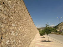 Wall. A stone wall under a blue sky stock photo