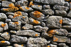 Wall of stones. With mossy spots. Spain Royalty Free Stock Image