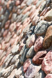 Wall of stones and cobbles. Background. Royalty Free Stock Image