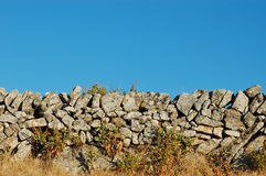 Wall of stones. In the field against the sky Stock Photo