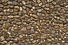 Wall of stones. Golden wall of stones, rock wall royalty free stock photos