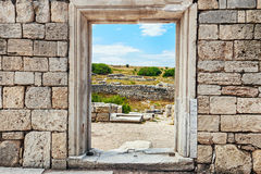 Wall of stones with a hole under the door. Cultural monument Che. Rsonese, Sevastopol, Crimea Stock Photography