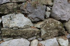 Wall of stones. Wall made of irregular stones used in a village of Pyrenees to divide two fields Royalty Free Stock Image