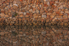 Wall stones and water reflection. Royalty Free Stock Photography