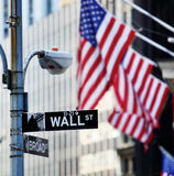 Wall street. Sign in New York with New York Stock Exchange background Royalty Free Stock Images