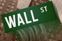 Wall Street. Street sign with building and charts in the background Royalty Free Stock Image