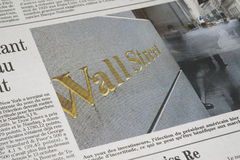 A Wall Street article. In a newspaper royalty free stock photo