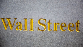 Wall street carved in stone. With golden letters. Manhattan, New York City Royalty Free Stock Photo