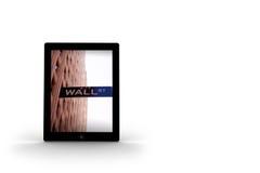 Wall Street en la pantalla de la tableta Imágenes de archivo libres de regalías