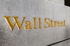 Wall Street golden inscription on a building. Stock Photos