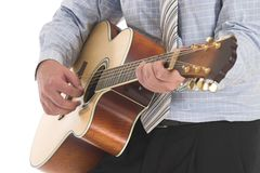 Wall Street Mariachi. Businessman playing a brown old guitar over white Stock Images