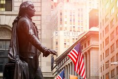 Wall Street in New York City at sunset Royalty Free Stock Photo