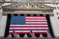 Wall street New York Stock Exchange with American flag. Photo of: Wall street New York Stock Exchange with American flag Royalty Free Stock Photography
