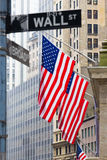 Wall street, New York, USA. Wall street sign in New York with American flags and New York Stock Exchange background Royalty Free Stock Photo