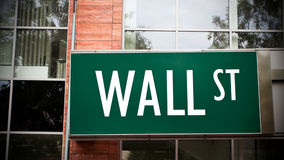 Wall Street Sign. Wall Steet street sign on office building, financial concept Royalty Free Stock Photo