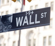 Wall street sign. Reflecting business stock images