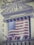 Wall street sign with american flags.  stock photos