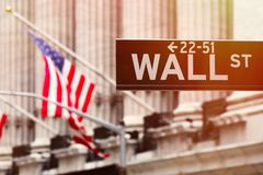 Wall street sign with the New York Stock Exchange on the background Stock Images