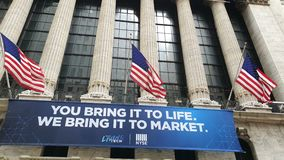 Wall Street sign in New York Stock Exchange with flags of the United States. New York, USA - NOV 4, 2019: Wall Street sign in New York Stock Exchange with flags stock video