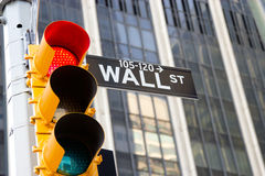 Wall Street Sign and red traffic light, New York royalty free stock photography