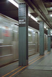 Wall Street Station Blur New York USA. New York City subway train arriving at the Wall Street station stock images