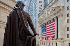 Wall Street Stock Exchange building with George Washington statue back. NEW YORK - SEPTEMBER 8: Wall Street Stock Exchange building with big US flag and George stock images