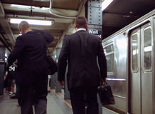 Wall Street Subway Station New York USA. Early morning subway commuters to Wall Street stock image
