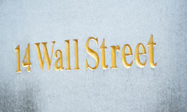 14 Wall Street. Text '14 wall street' in uppercase gold letters engraved in a stone at the entrance to a skyscraper in New York which was originally Bankers Stock Photography