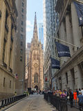 Wall Street and Trinity Church in New York City Stock Image
