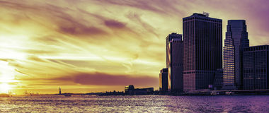 Wall Street und das Freiheitsstatue bei Sonnenuntergang, New York City Lizenzfreies Stockbild