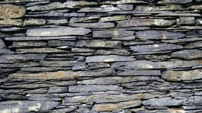 Stone wall of bygone years. The wall is a structural element in architecture and construction, creating an external perimeter of a building or room in the form royalty free stock photography
