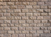 Wall surface of the decorative stones brown Stock Images