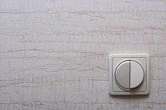 The wall switch at the bottom right. Wall with Wallpaper and a switch located at the bottom right Stock Photos