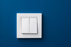 Wall switch. Switch-gang white on blue wall Royalty Free Stock Photography