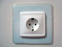 Wall switch socket. In a light-blue plastic frame Royalty Free Stock Images