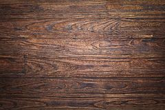 Wall, table, dark brown, brown wood, planks, pine, background, wooden shelf, twinkle lights, wooden counter, wood texture,. Empty wooden background. Wood texture royalty free stock image