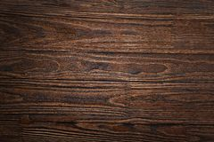 Wall, table, dark brown, brown wood, planks, pine, background, wooden shelf, twinkle lights, wooden counter, wood texture,. Empty wooden background. Wood texture royalty free stock photos