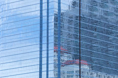 Wall of tall building or blue glass of skyscraper background. Royalty Free Stock Image
