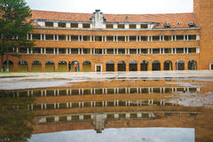 Wall of Teacher College of Dalat after the rain Stock Image