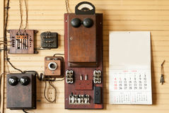 Wall of Telephone Equipment in Train Depot. Wall of Telephone/Telegraph Equipment in Train Depot - vintage with 1954 calendar & keys Royalty Free Stock Image