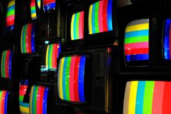 Wall of television sets with coloured strips royalty free stock photography