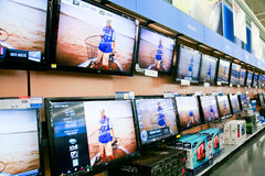 Wall of Televisions at Store stock photos