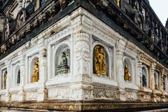 Wall of the temple that decorated with many forms and cultures of antique Buddha statues at Mahabodhi Temple at Bodh Gaya. Wall of the temple that decorated royalty free stock image
