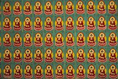 The wall in the temple is filled with buddhas. Religion Buddhism concept. Texture, background Buddhism.  royalty free stock photography